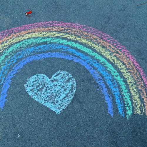 Colourful chalk drawing of a rainbow