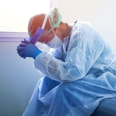 Image of exhausted doctor in PPE