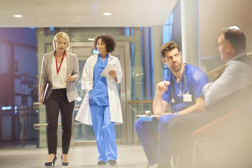 Hospital consultants walking down a corridor.