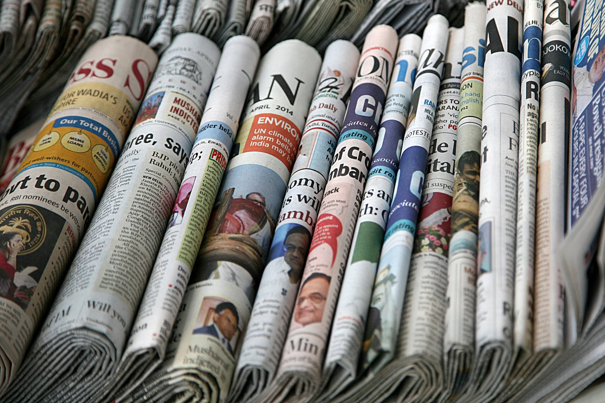 A row of different newspapers